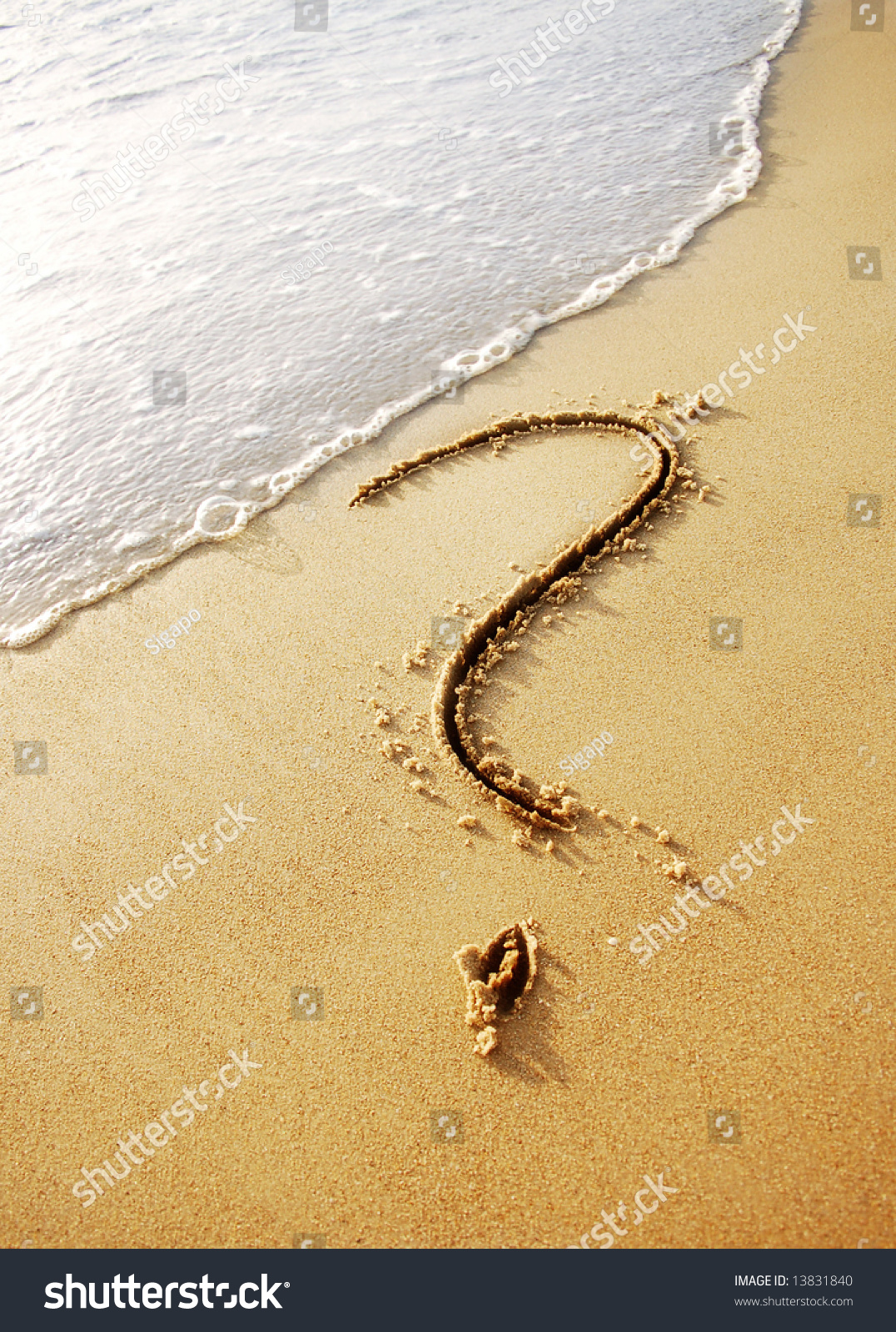 Question mark sign in sand beach Stock Photo 13831840