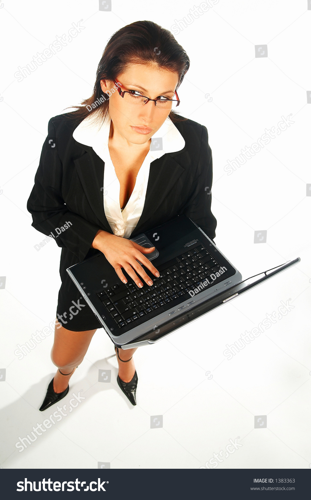 Sexy Business women isolated on white holding laptop computer