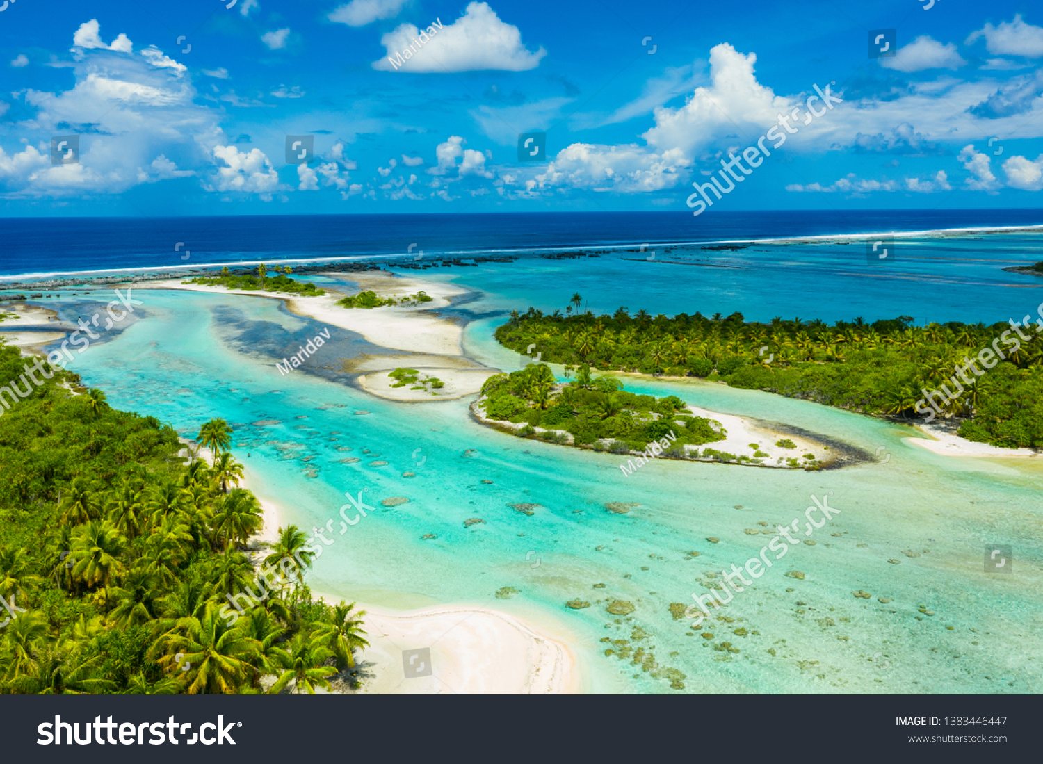 Rangiroa aerial drone video of atoll island motu and coral reef in French Polynesia, Tahiti. Amazing nature landscape with blue lagoon and Pacific Ocean. Tropical island paradise in Tuamotus Islands. #1383446447