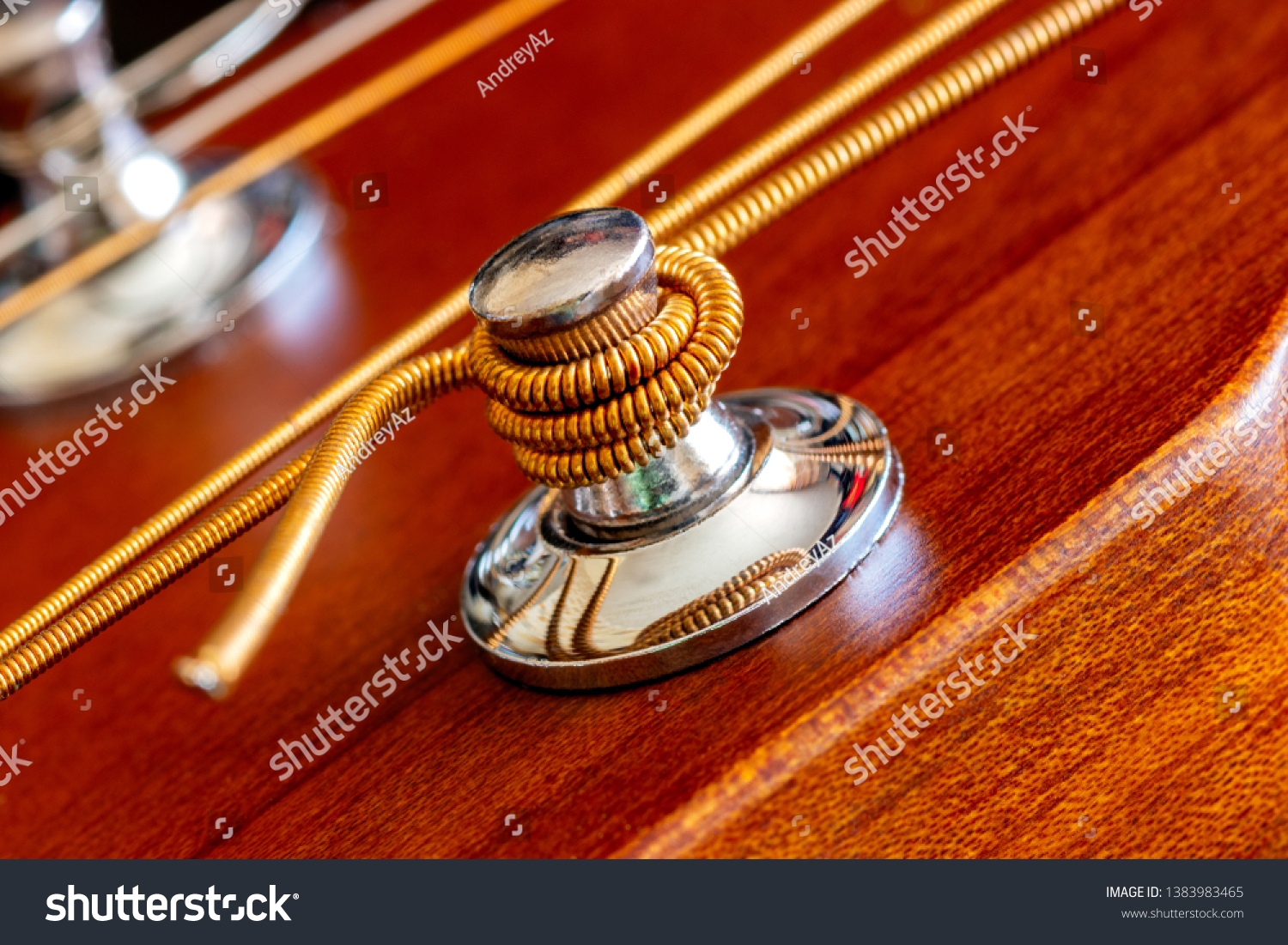 Fastening of a string on an acoustic guitar. Macro shooting #1383983465