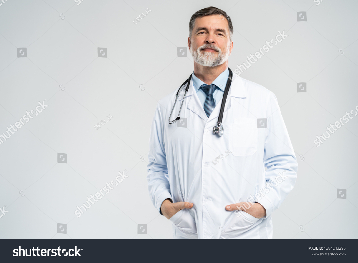 Cheerful mature doctor posing and smiling at camera, healthcare and medicine #1384243295