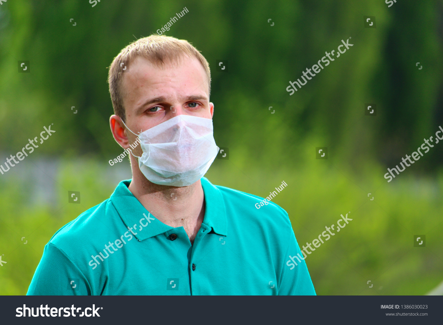 A man in a mask on a blurred background of nature #1386030023
