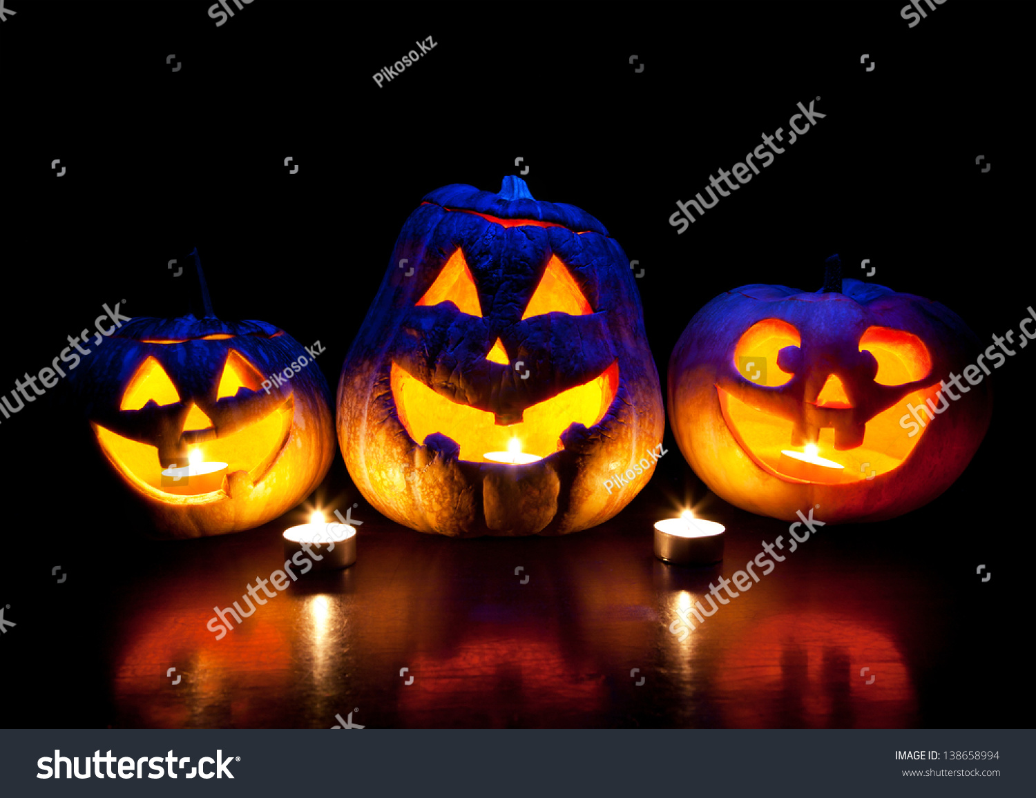 scary halloween pumpkins eyes glowing inside stock photo (edit now