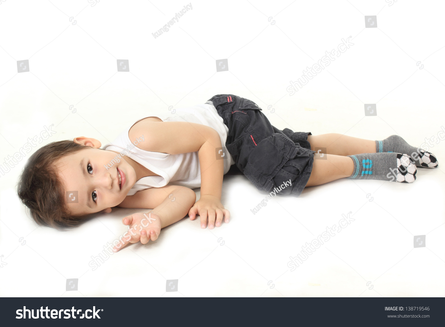 Little boy lie down on floor stock photo 138719546 for Down to the floor
