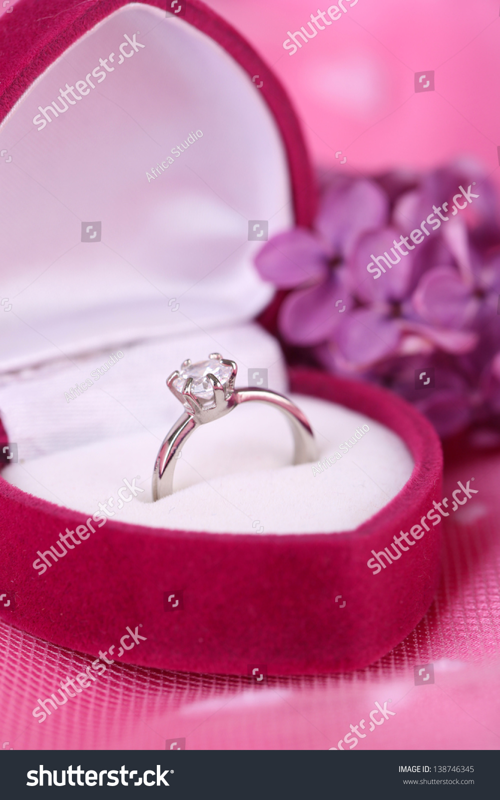 beautiful box wedding ring on purple stock photo 138746345