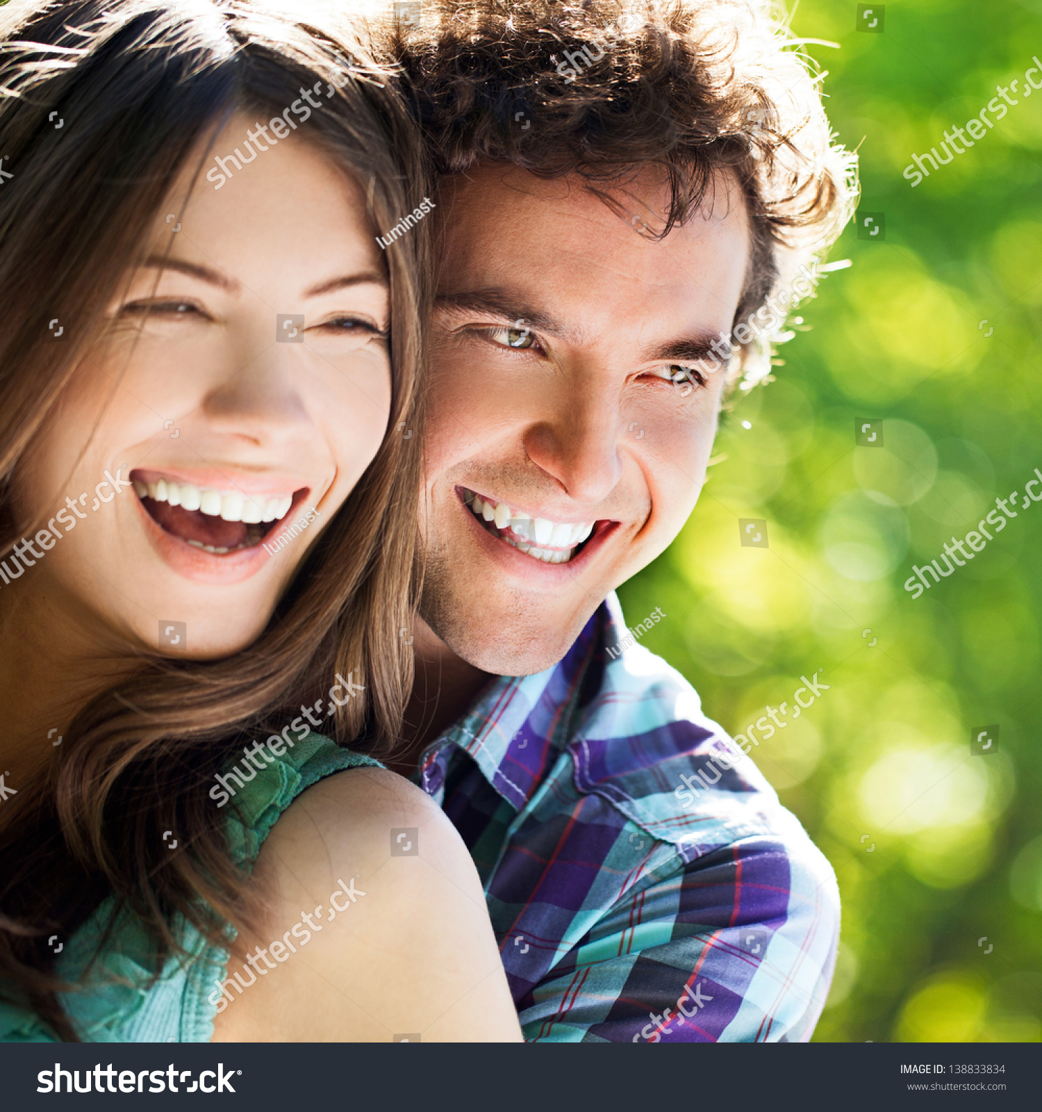 Young happy couple hugging and laughing. Young Happy Couple Hugging Laughing Stock Photo 138833834
