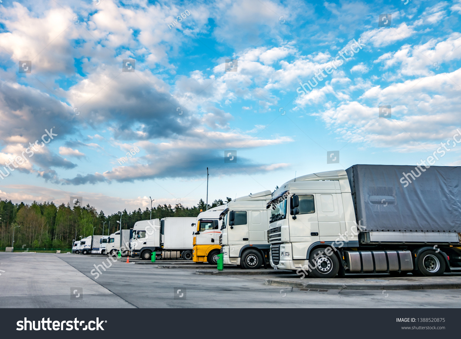 Trucks in a row with containers in the parking lot near forest , Logistic and Transport concept #1388520875