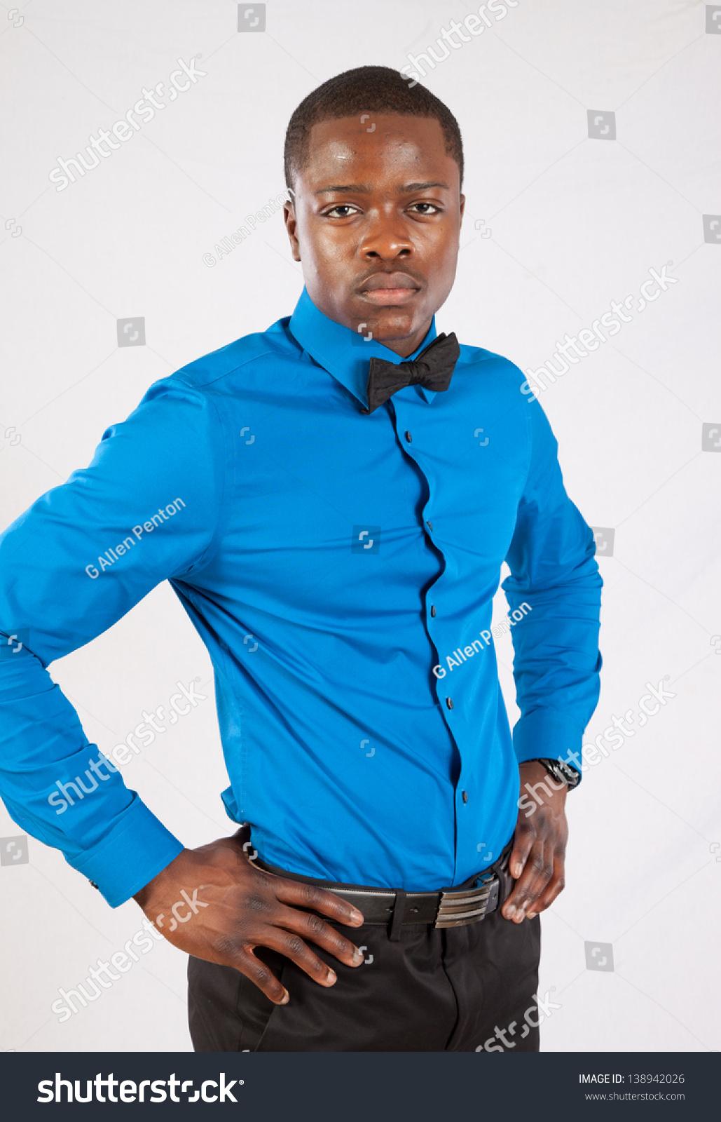 Handsome black man in blue long sleeve shirt and bow tie for Black and blue long sleeve shirt