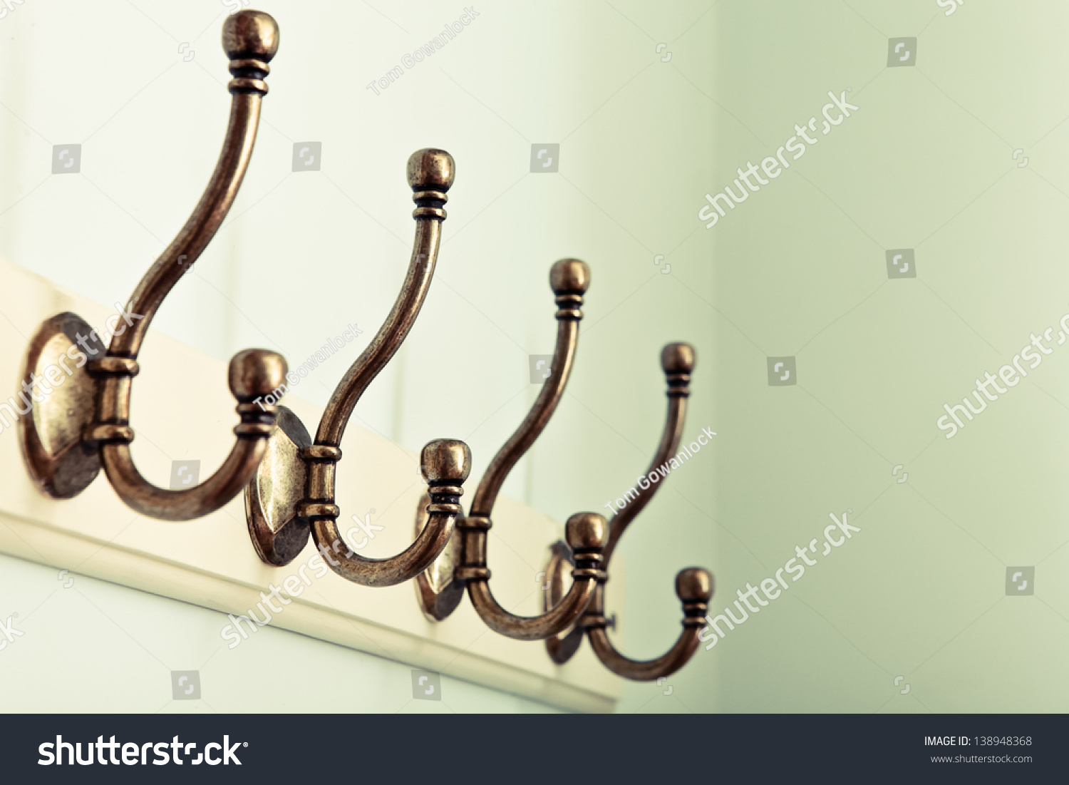 Row of vintage coat hooks on a wooden plaque stock photo 138948368 shutterstock - Cast iron row of hooks ...