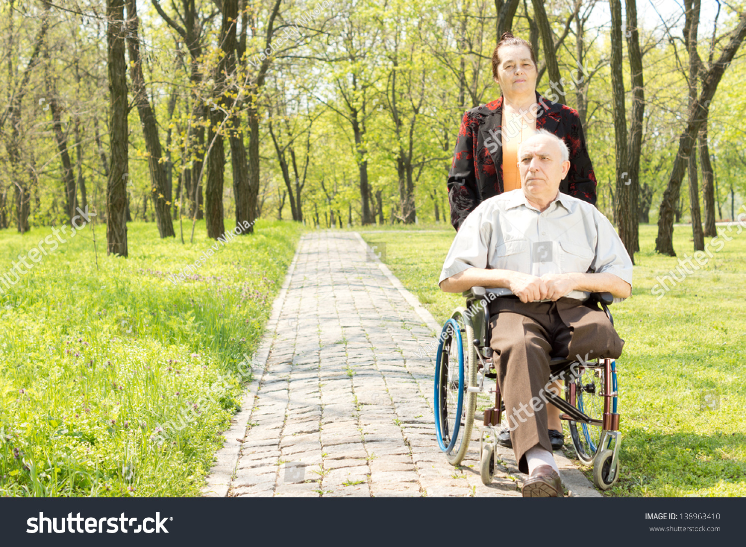 Wife Walking Disabled Man Wheelchair Who Stock Photo ...