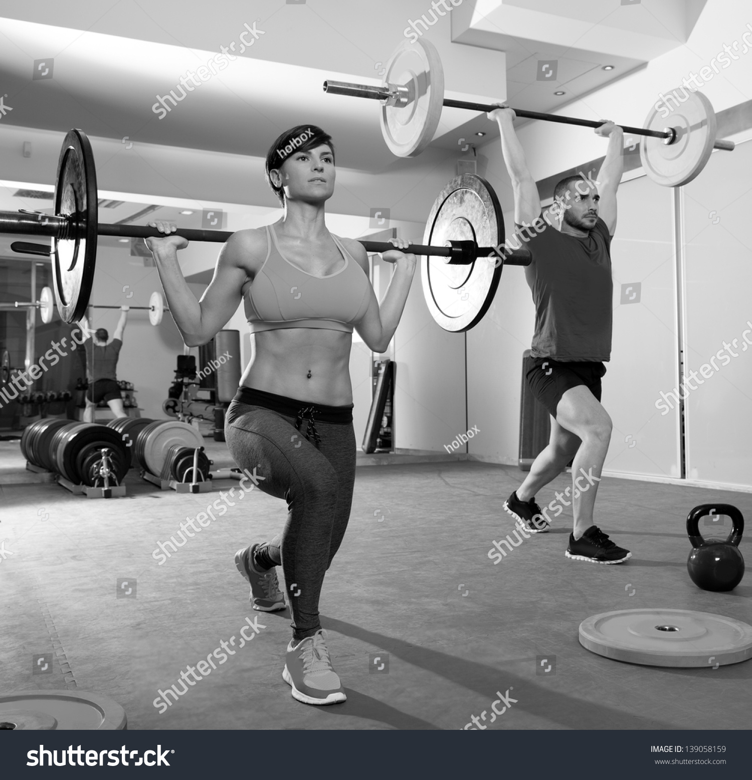 Crossfit fitness gym weight lifting bar stock photo 139058159 crossfit fitness gym weight lifting bar by woman and man group workout platinumwayz