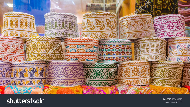 Colorful Omani Caps on retail display during Ramadan.