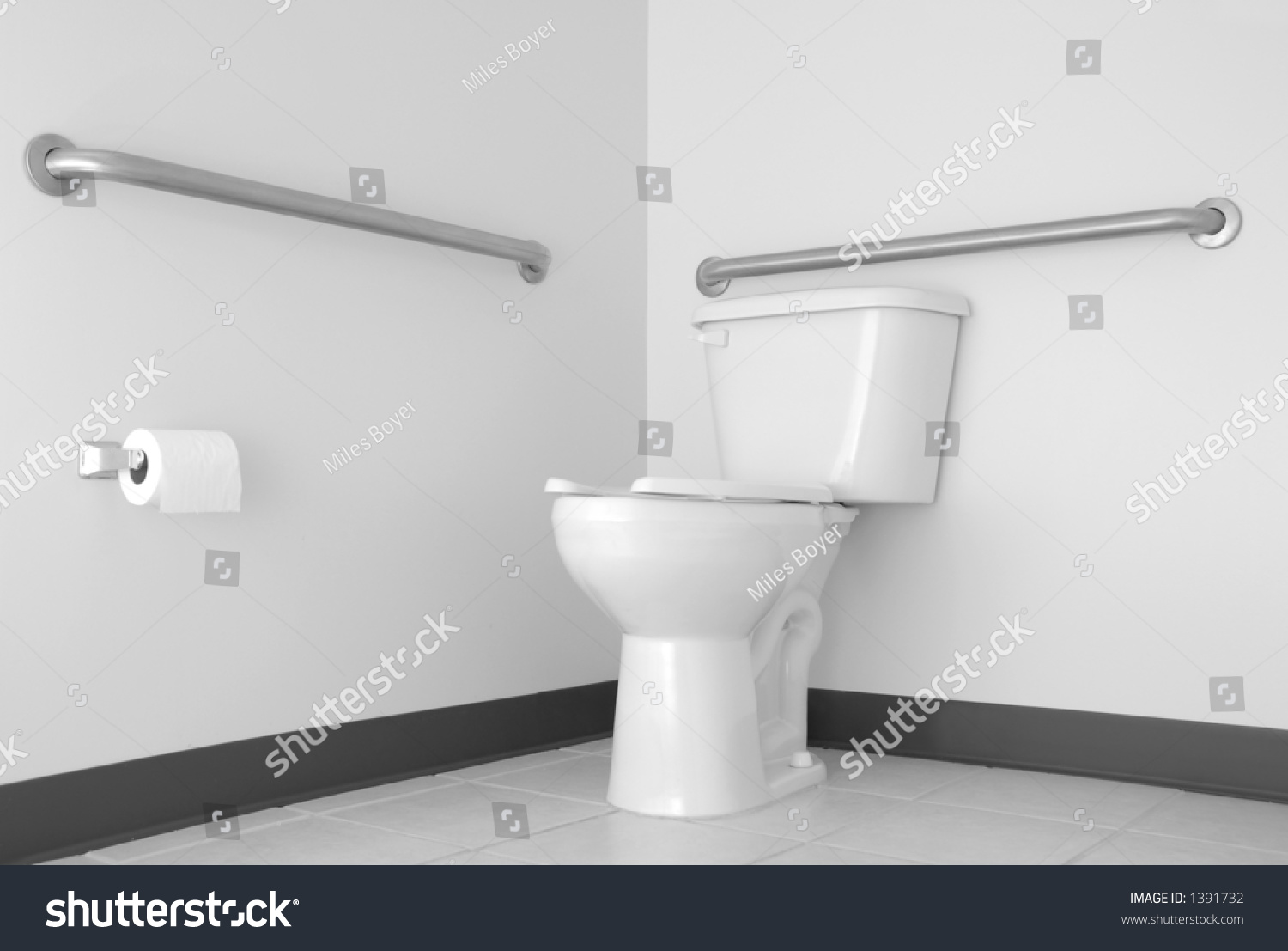 Simple toilet bathroom with ada grab bars stock photo - Handicap bars for bathroom toilet ...