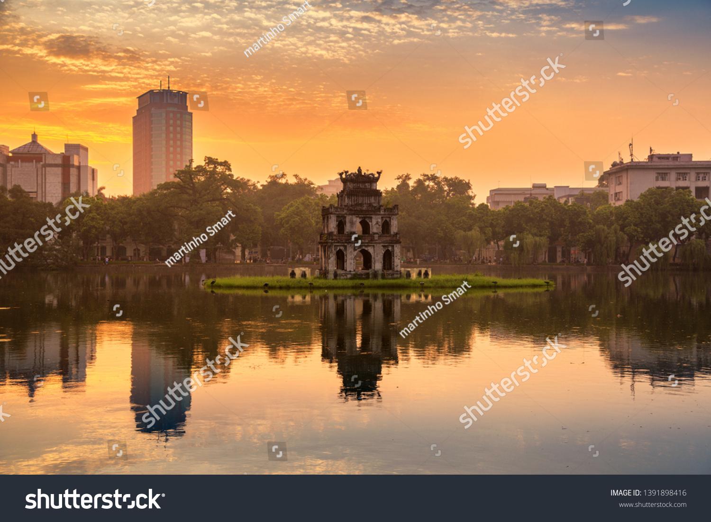 Hoan Kiem Lake (Lake of the Returned Sword) and the Turtle Tower in Hanoi , Vietnam #1391898416