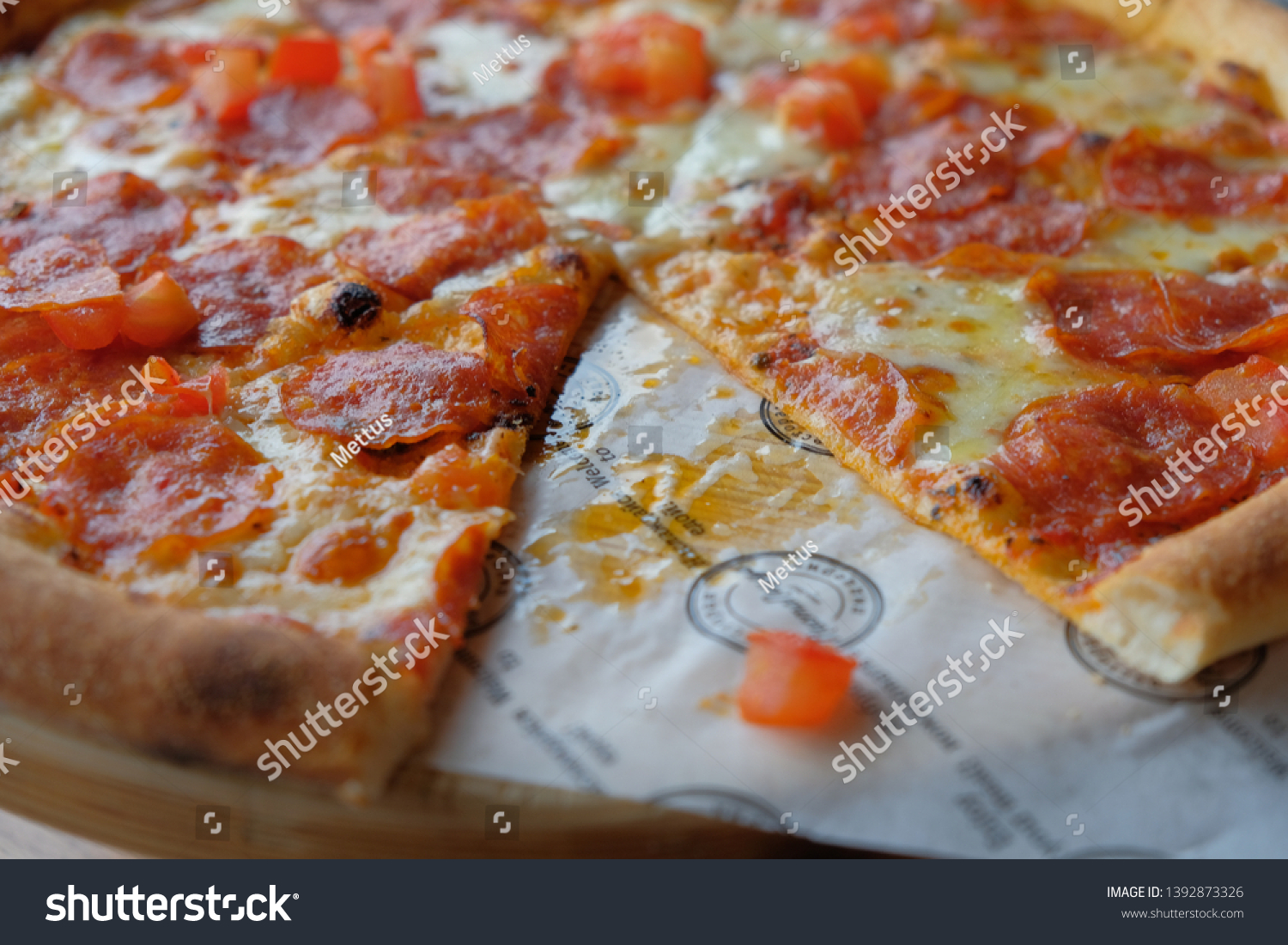 stock-photo-pepperoni-pizza-with-one-pis
