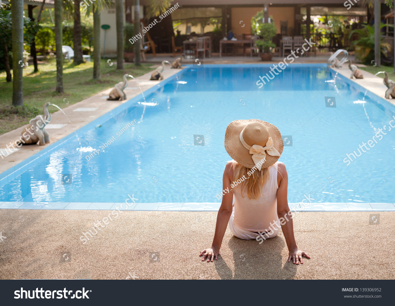 Woman In Luxury Spa Resort Near The Swimming Pool Stock Photo 139306952 Shutterstock