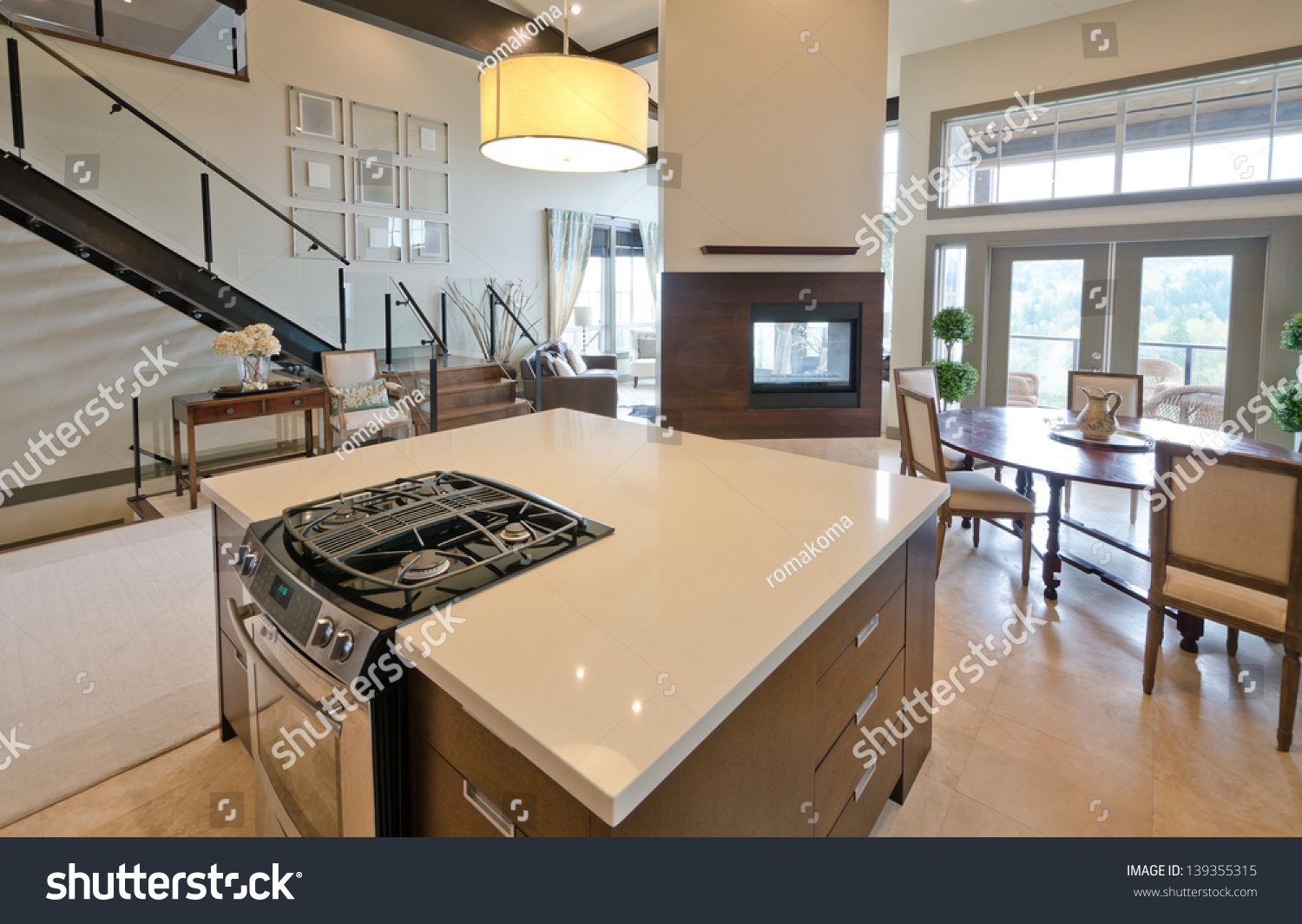 Modern kitchen fireplace - Luxury Modern Kitchen With The Living Room And The Fireplace At The Back Interior Design