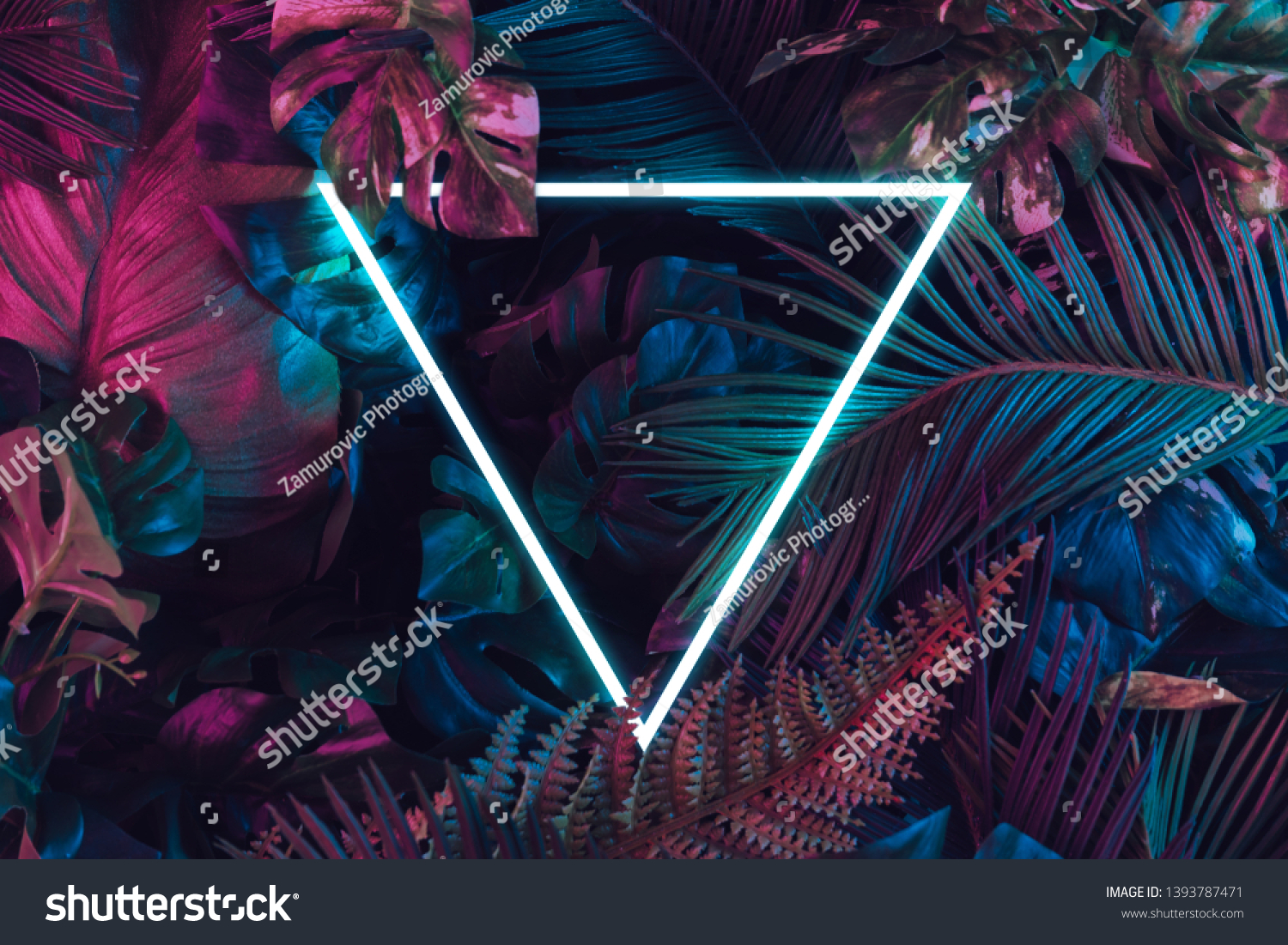 Creative fluorescent color layout made of tropical leaves. Flat lay neon colors. Nature concept. #1393787471