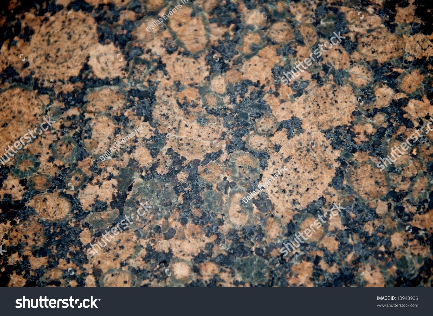 Red And Black Granite : Image of a black tan and pink patterned granite close up