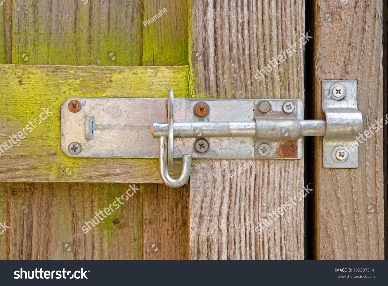 Lock latch on wooden garden gate stock photo