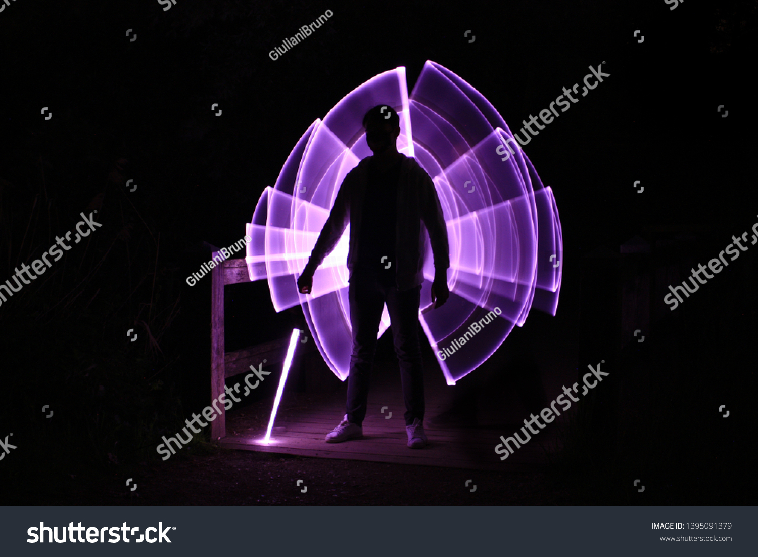Silhouette Man Standing Lightsaber Neon Drawings People Stock Image 1395091379