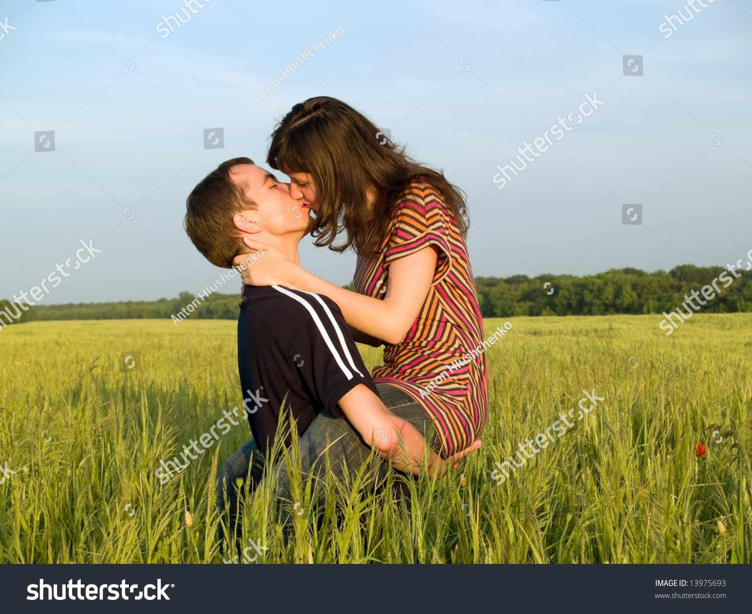 young couple sex field