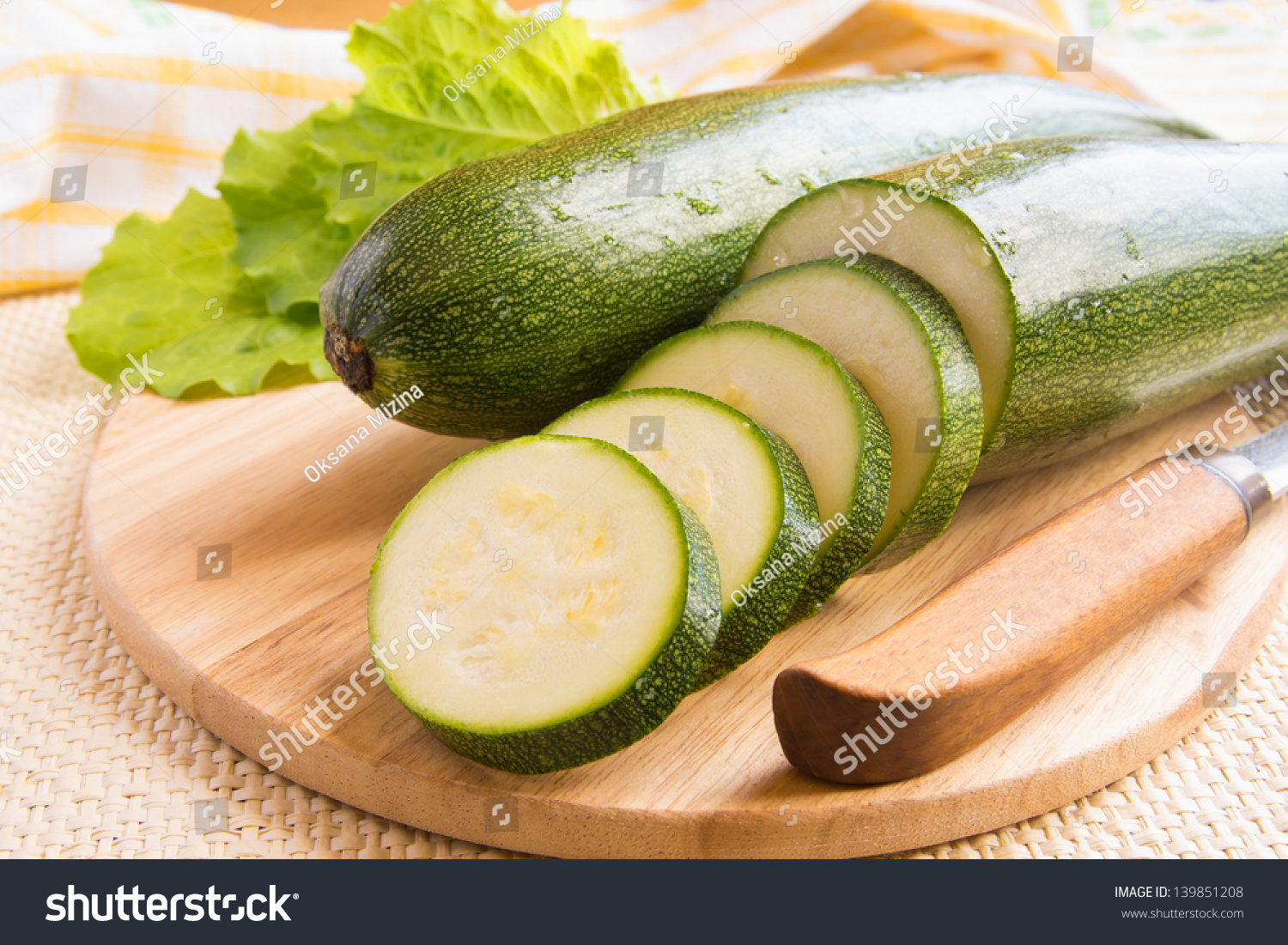 Green Zucchini Sliced And Whole With Knife On Wooden ...