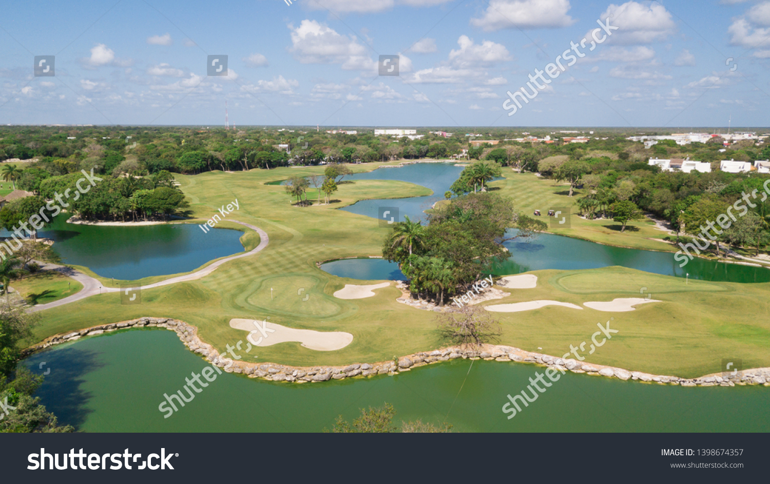 Golf course with gorgeous green and pond. Aerial view of a beautiful green golf course #1398674357