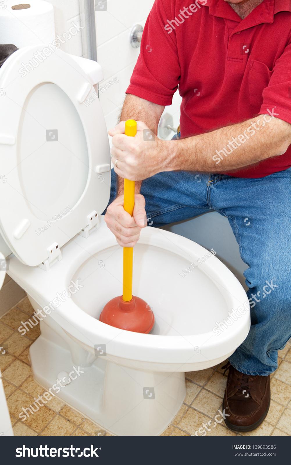 plumber homeowner using plunger unclog toilet stock photo 139893586 shutterstock. Black Bedroom Furniture Sets. Home Design Ideas
