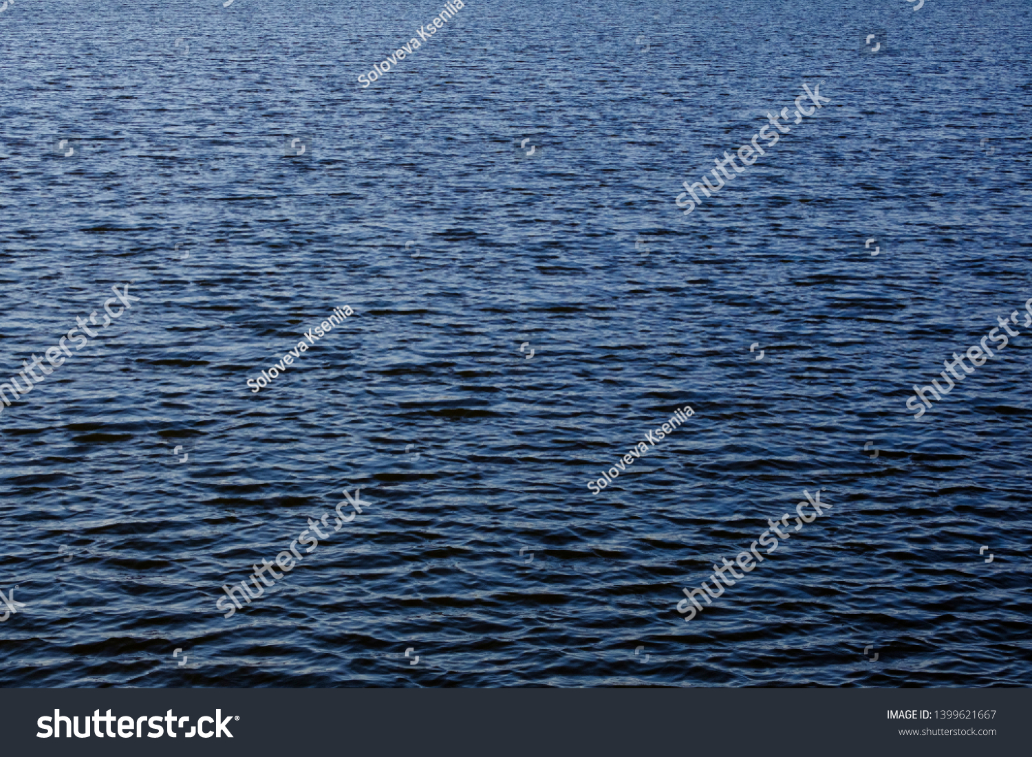 Light playing on the sea surface. Water surface. Sea surface. Water background. Blue water surface. Abstract blue water  #1399621667