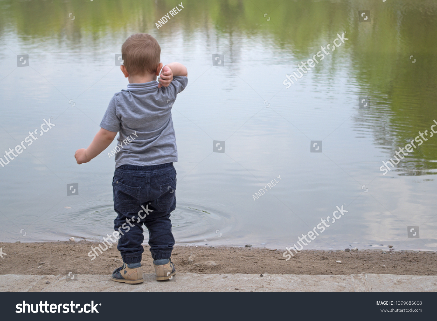 stock-photo-a-little-boy-in-a-gray-t-shi