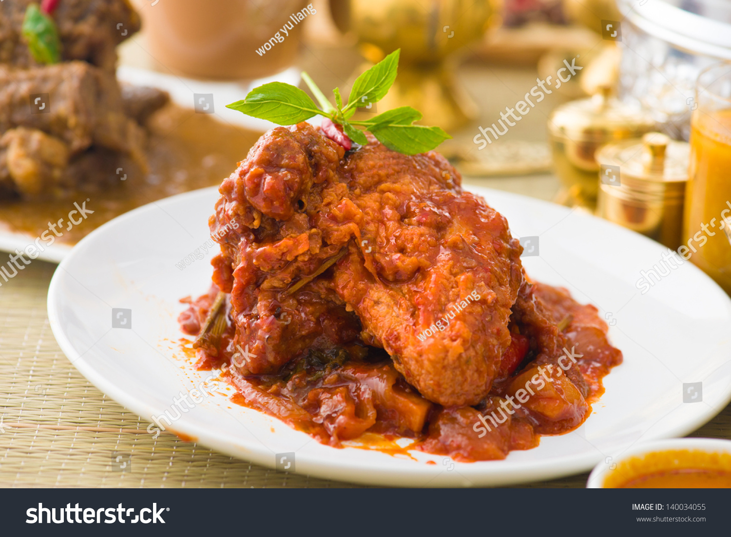 curry chicken rendang cooked in indian style with spicy sauce and ...