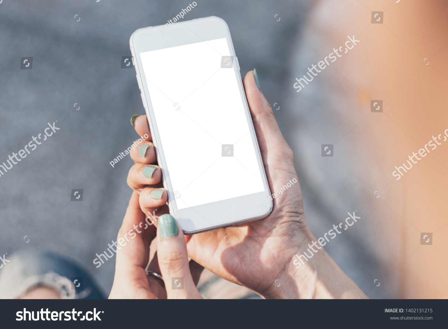 Mockup image woman hand holding texting using mobile,cell phone with copy space,white blank screen for text.concept for contact business,people communication,technology electronic device #1402131215