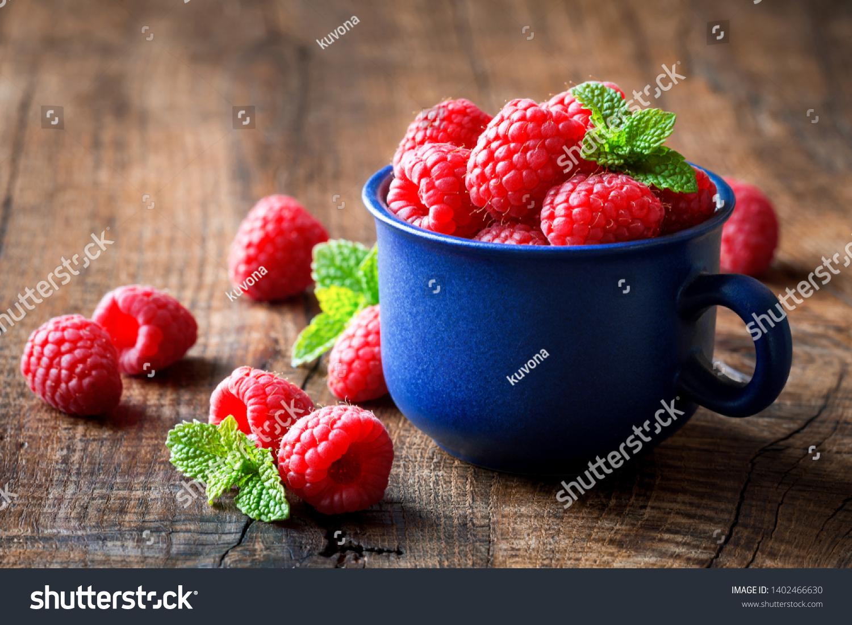 stock-photo-fresh-ripe-red-raspberries-i