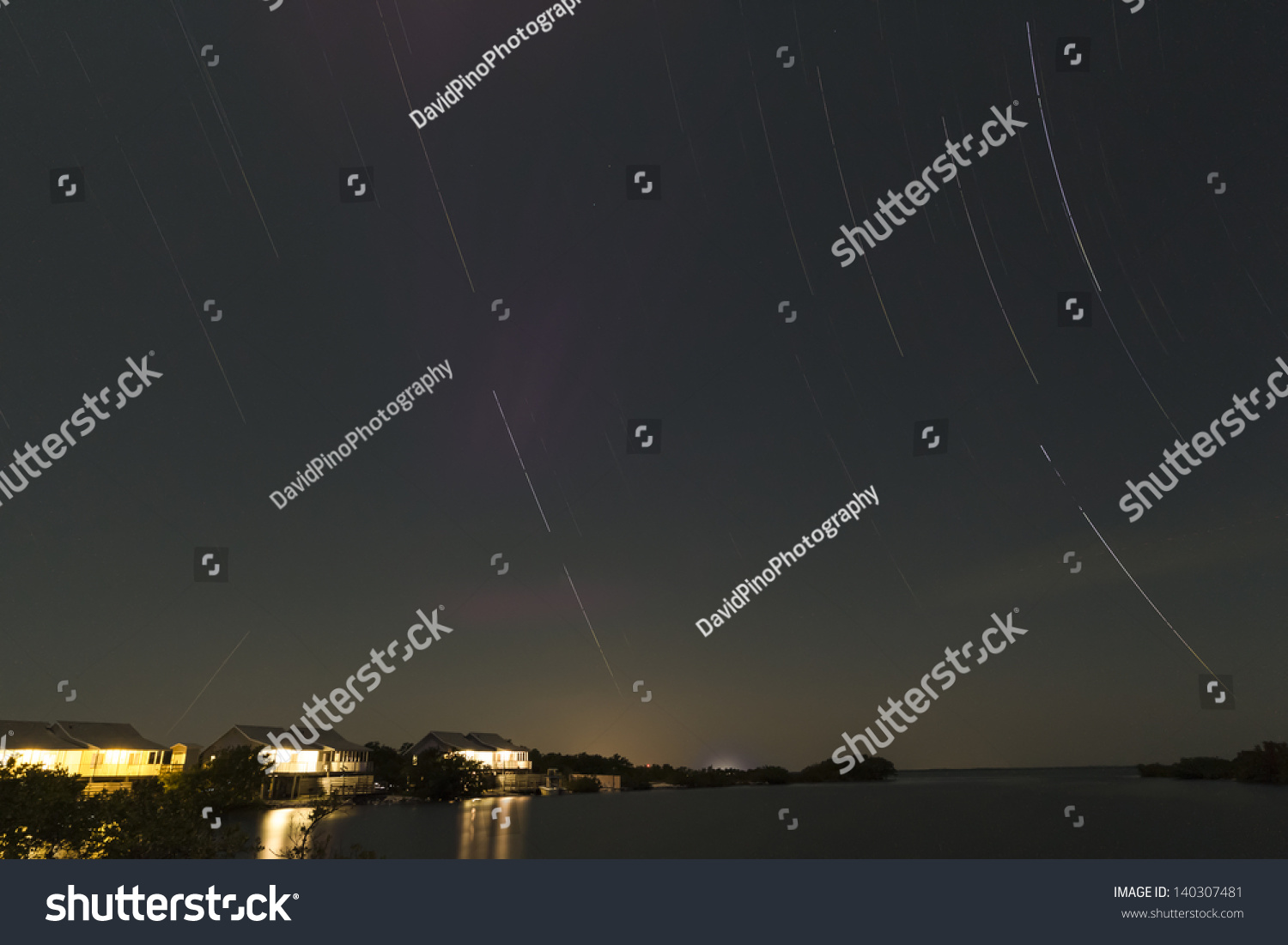 Star trails at night over the ocean and a cabin by the sea for Cabin by the sea