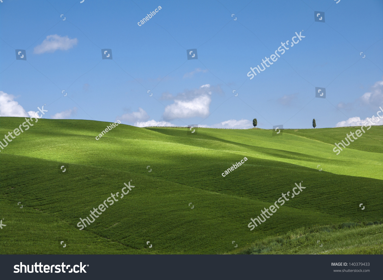 Green fields and blue sky tuscany italy stock photo for Green italy