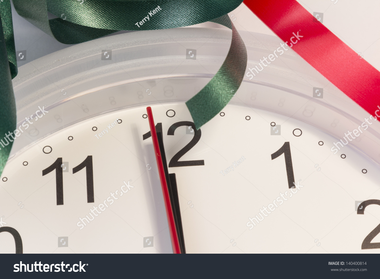 Clean White Clock Showing Five Seconds To Midnight Stock