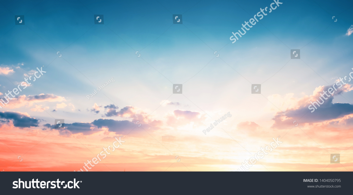 Background of colorful sky concept: Dramatic sunset with twilight color sky and clouds #1404050795