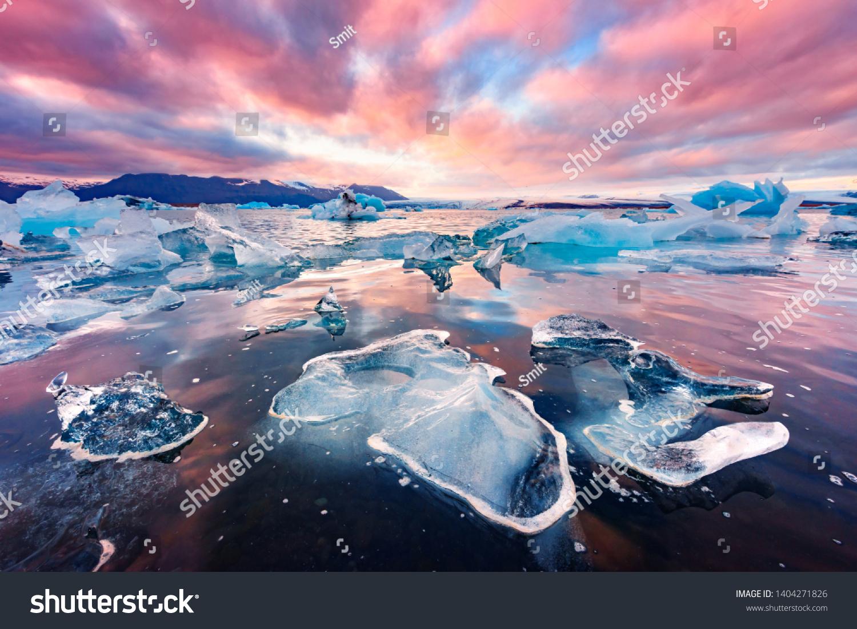 Incredible landscape with icebergs in Jokulsarlon glacial lagoon. Vatnajokull National Park, southeast Iceland, Europe. #1404271826