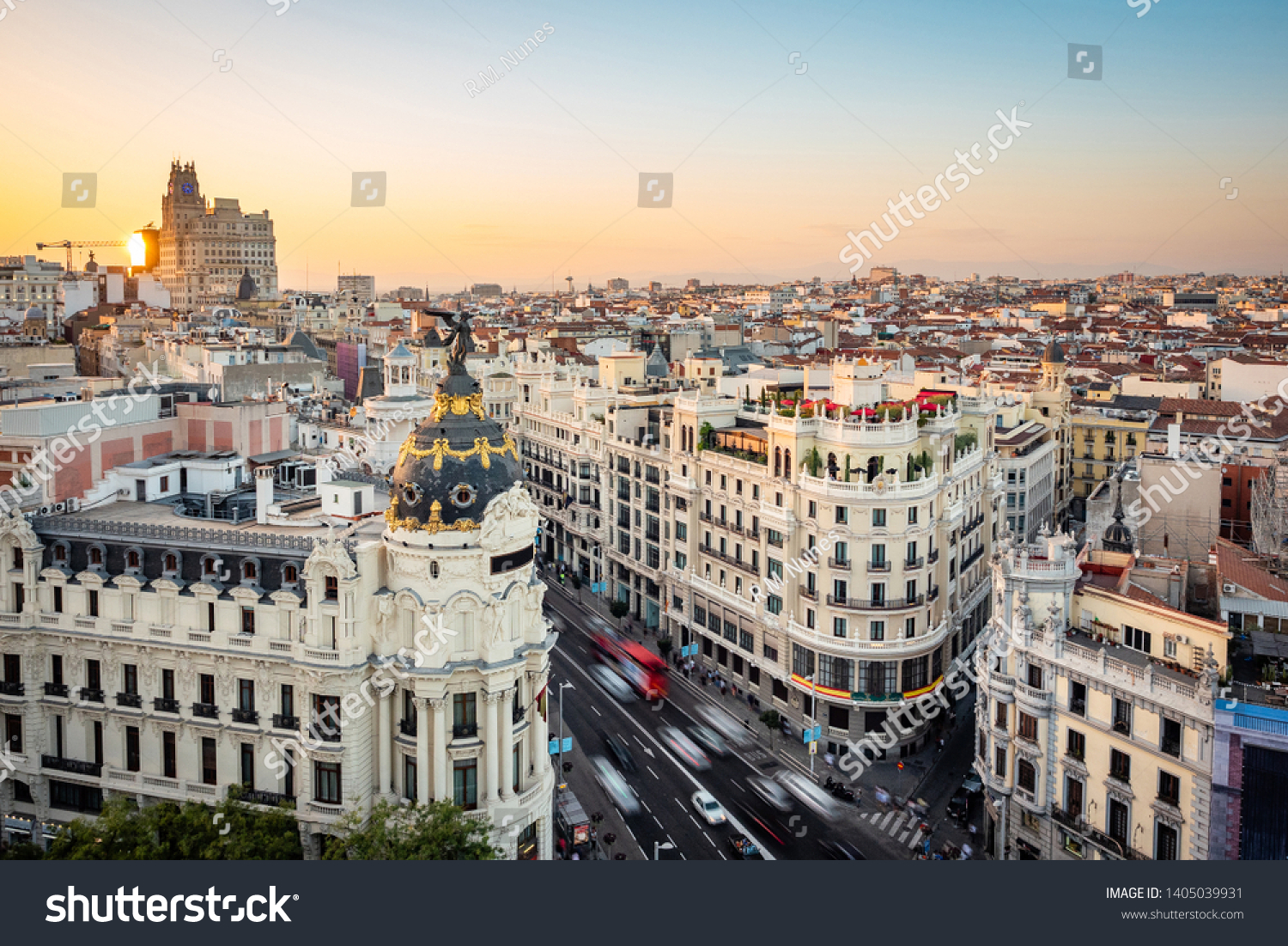 Madrid, Spain, sunset over landmark buildings on Gran Via street.  #1405039931