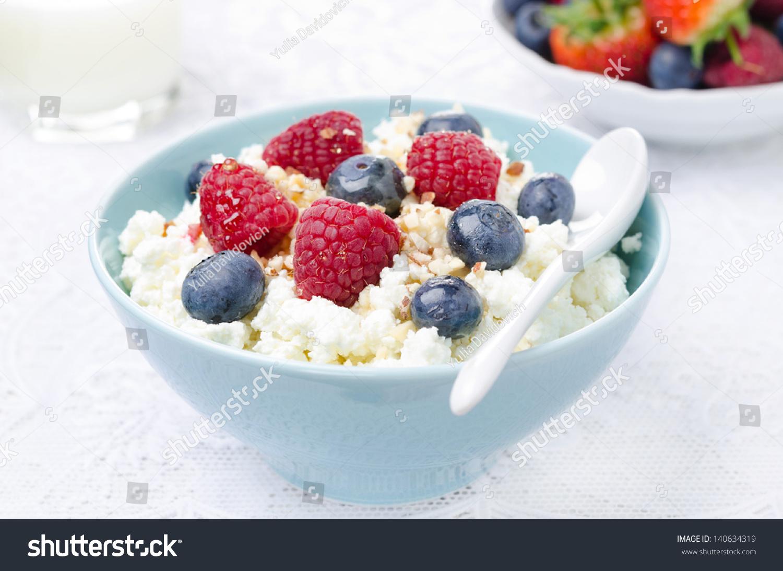 cottage cheese berries honey nuts fresh stock photo 140634319