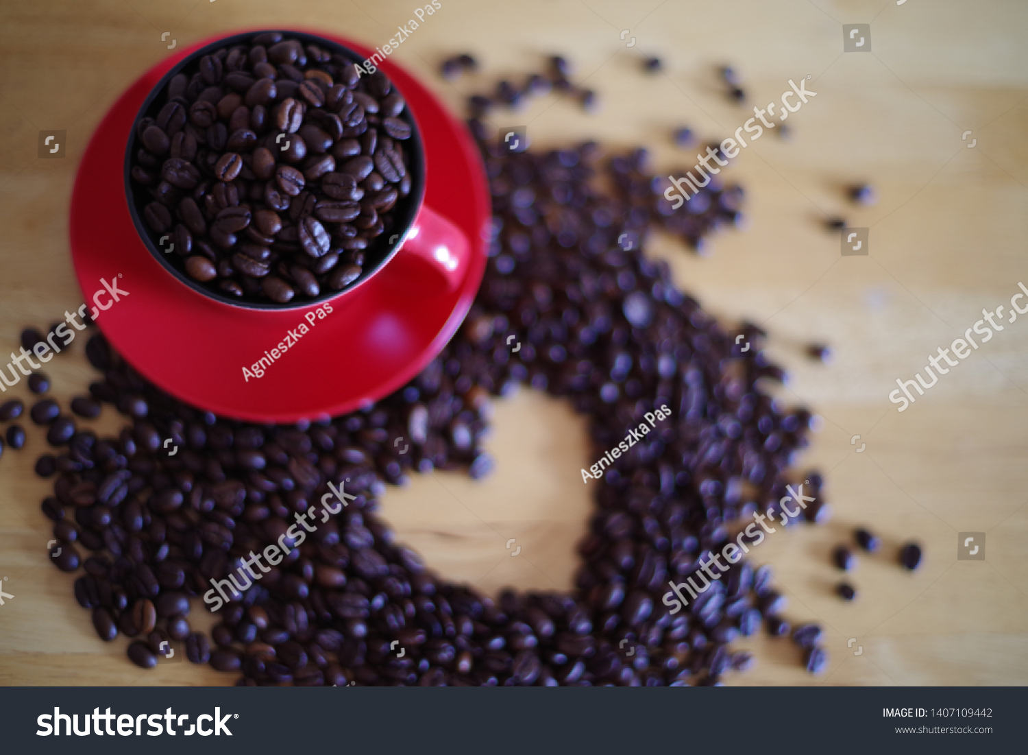 stock-photo-coffee-beans-in-red-cup-and-