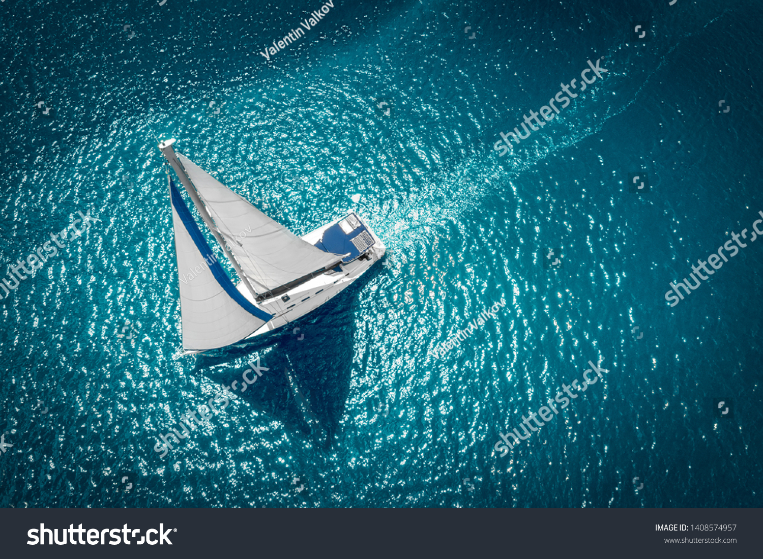 Regatta sailing ship yachts with white sails at opened sea. Aerial view of sailboat in windy condition. #1408574957