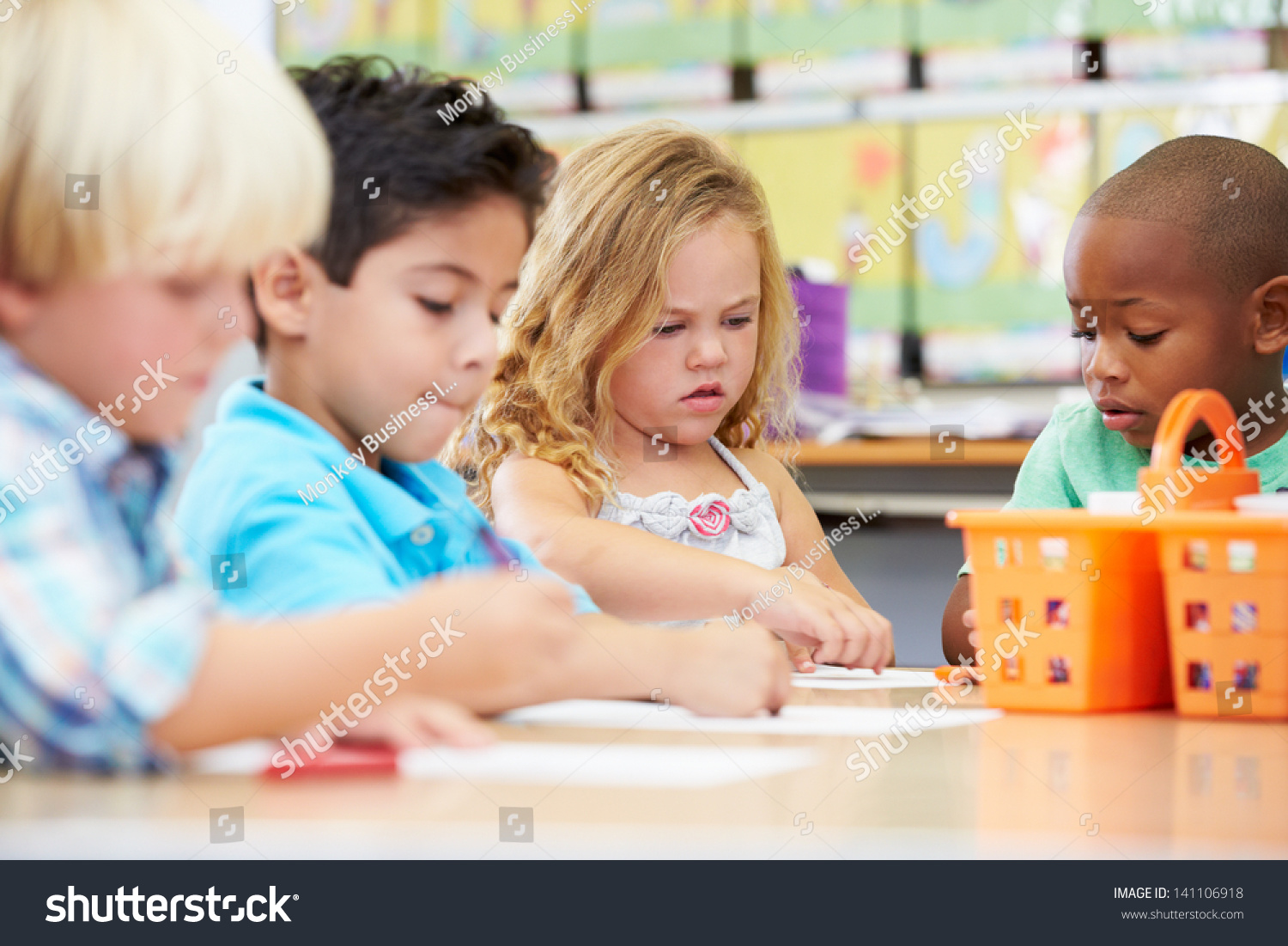 Schoolgirls learning together in primary school classroom  Elementary age  children  Stock Photo           Scholastic