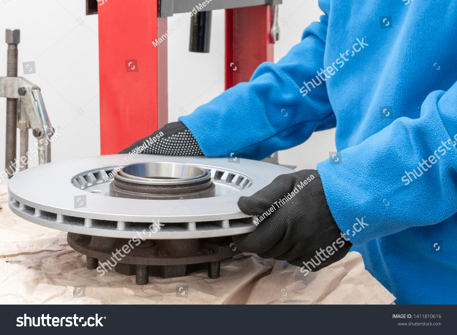 stock-photo-a-mechanic-is-placing-a-new-