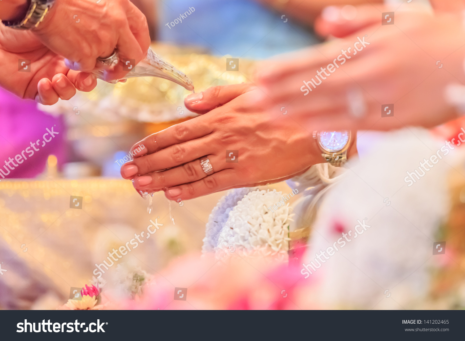Hands Pouring Blessing Water Into GroomS Bands Thai Wedding Ceremony Stock Photo 141202465