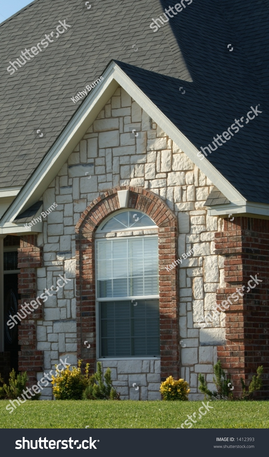 Cottage Style Brick And Stone Design On A Newly Built Home