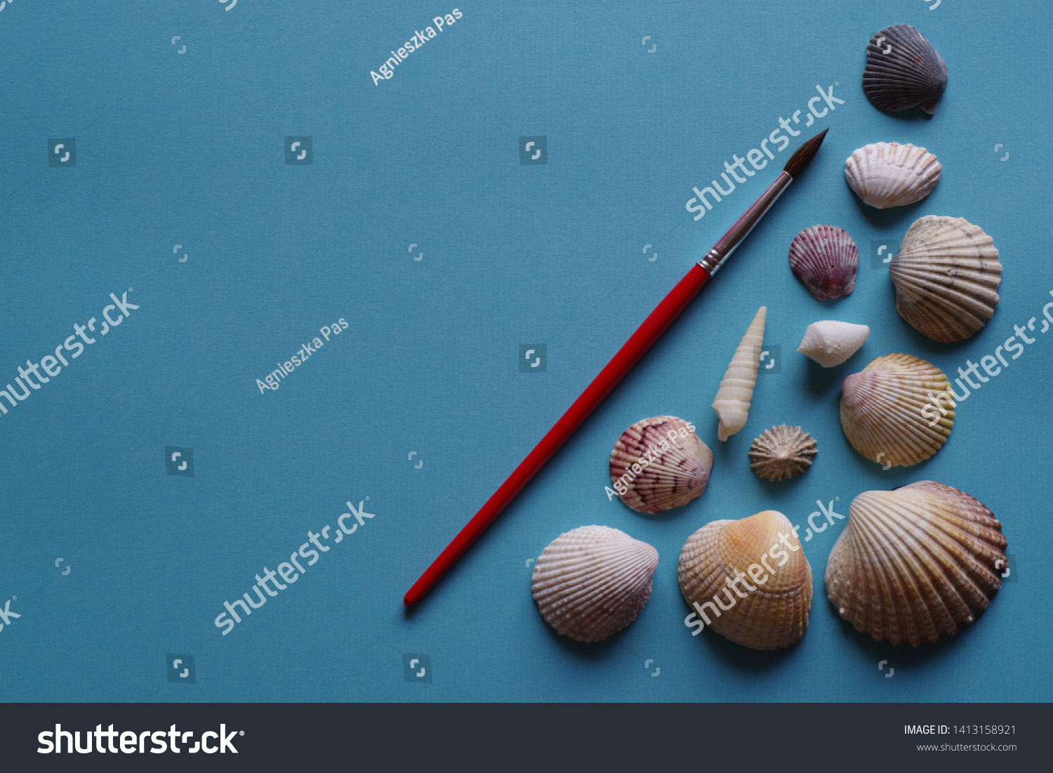 stock-photo-paintbrush-and-seashells-on-