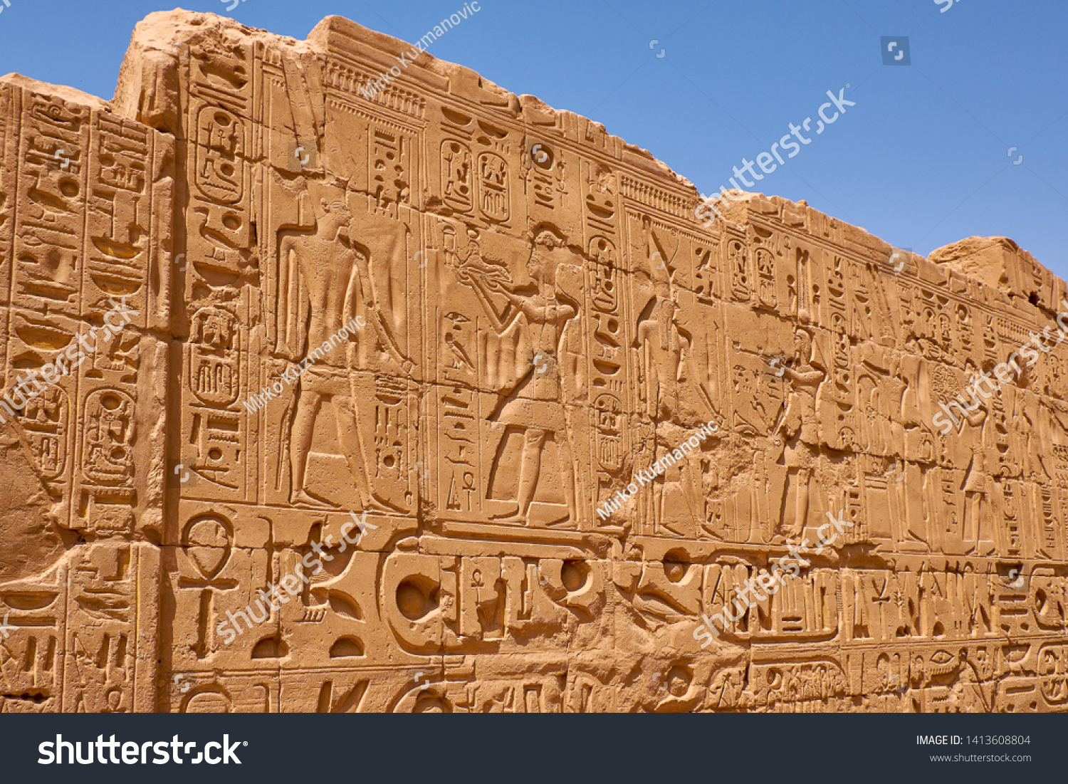 Relief details and Egyptian hieroglyphs at Karnak temple complex and Karnak Open Air Museum (about 1250 BC), Luxor, Egypt #1413608804