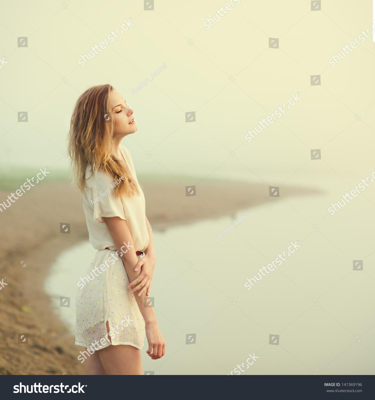 Happy Beautiful Natural Emotion Woman Joying On Blue Sea: Beautiful Girl On Beach Alone Stock Photo 141369196